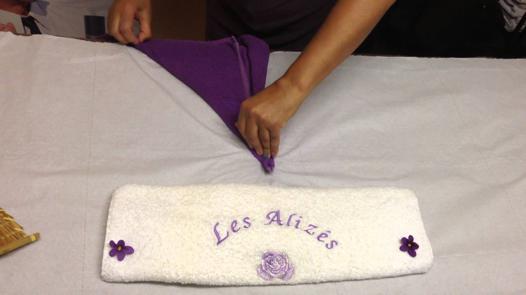 pliage de serviette de bain